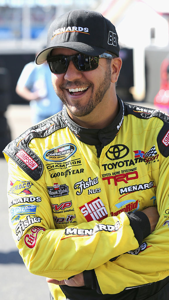 TALLADEGA, AL - OCTOBER 21:  Matt Crafton, driver of the #88 Shasta/Menards Toyota, stands in the garage area during practice for the NASCAR Camping World Truck Series fred's 250 at Talladega Superspeedway on October 21, 2016 in Talladega, Alabama.  (Photo by Jerry Markland/Getty Images)