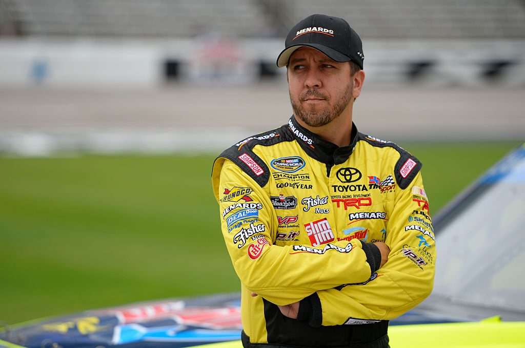 FORT WORTH, TX - NOVEMBER 04:  Matt Crafton, driver of the #88 DampRid/Menards Toyota, stands on the grid during Salute to Veterans Qualifying Fueled by Texas Lottery for the NASCAR Camping World Truck Series Striping Technology 350 at Texas Motor Speedway on November 4, 2016 in Fort Worth, Texas.  (Photo by Robert Laberge/Getty Images)